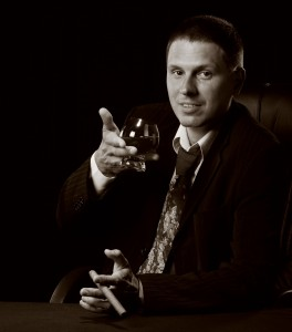 1558300-the-man-with-a-cigar-and-a-glass-of-cognac